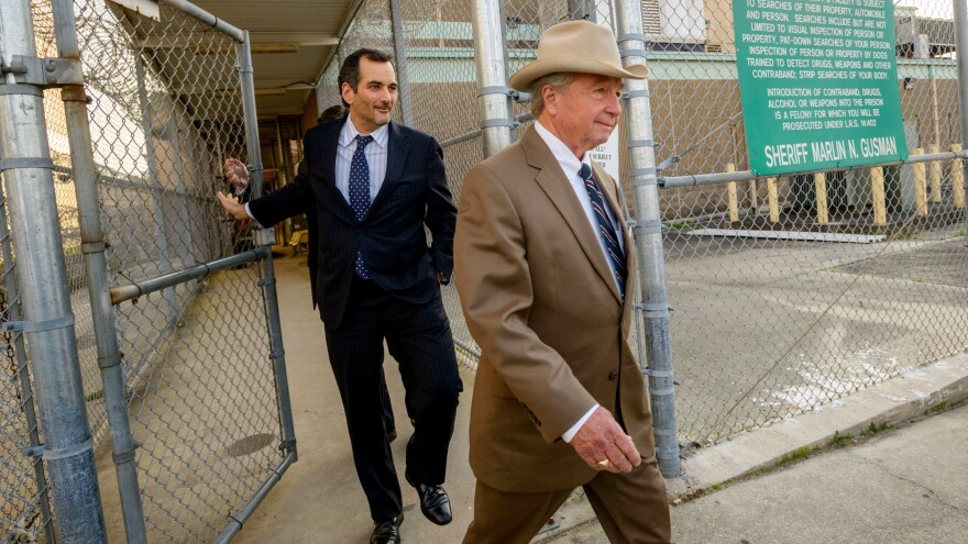 """Robert Durst's attorney, Dick DeGuerin (right), seen here in March 2015, often dons a Stetson Open Road, just like the cowboy hat worn by former President Lyndon B. Johnson, a friend of his father. """"He was a giant of a man, and he'd pick me up and put me on his knee,"""" DeGuerin says."""