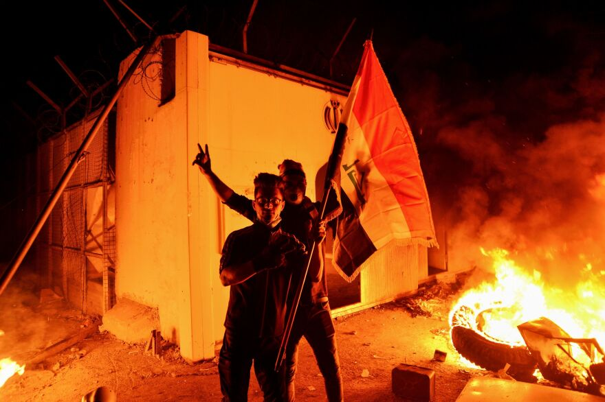 Iraqi demonstrators stormed and set fire to Iran's consulate in the southern Iraqi city of Najaf on Wednesday.