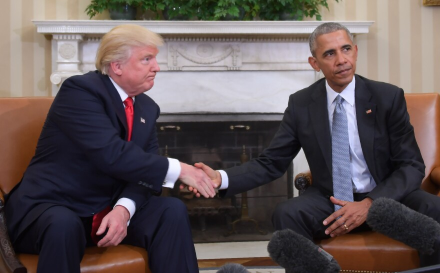 Then-President Obama and then-President-elect Donald Trump shake hands during a transition planning meeting in the Oval Office at the White House in November of 2016.