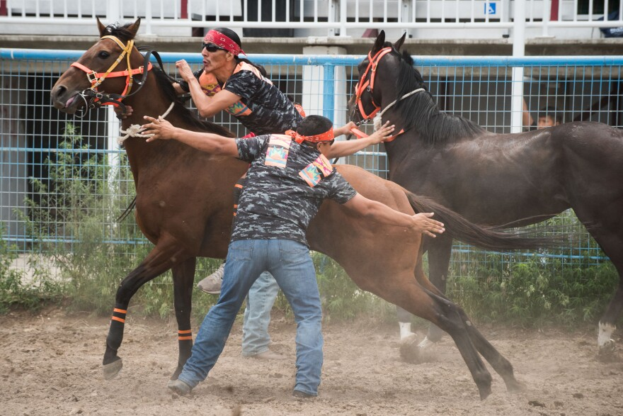 Photo of rider changing horses.