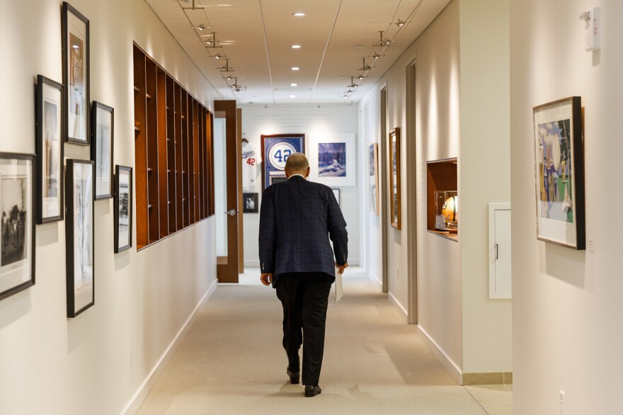 Selig walks down a hallway to his office. He has retired but he still works. It's someone else's job to meet the game's current challenges, such as attracting younger, more diverse fans and maintaining labor peace.