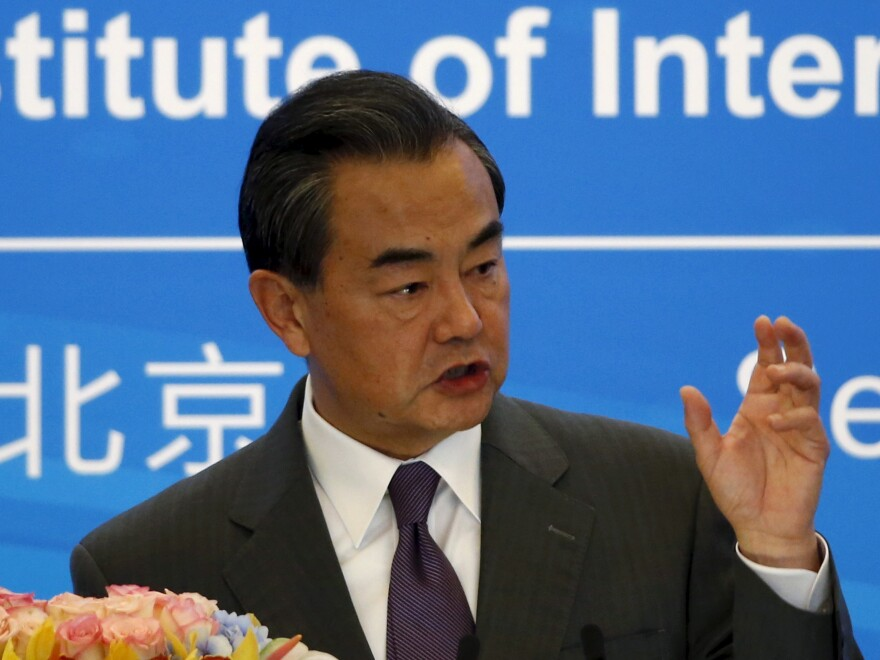 Chinese Foreign Minister Wang Yi delivers a speech during the international seminar commemorating the 10th anniversary of the September 19 joint statement of six-party talks at the Diaoyutai State Guesthouse in Beijing, China, on Saturday.