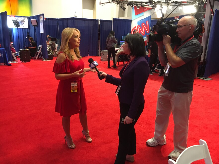 Gina Loudon, left, is interviewed by a television crew before the start of Sunday's debate. (Oct. 9, 2016)