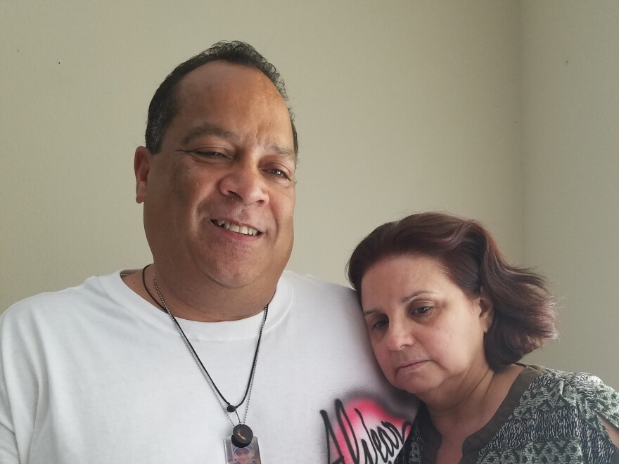 """Daniel Alvear and his wife, Mayra, in their home --€"""" hours before the funeral for Flores."""