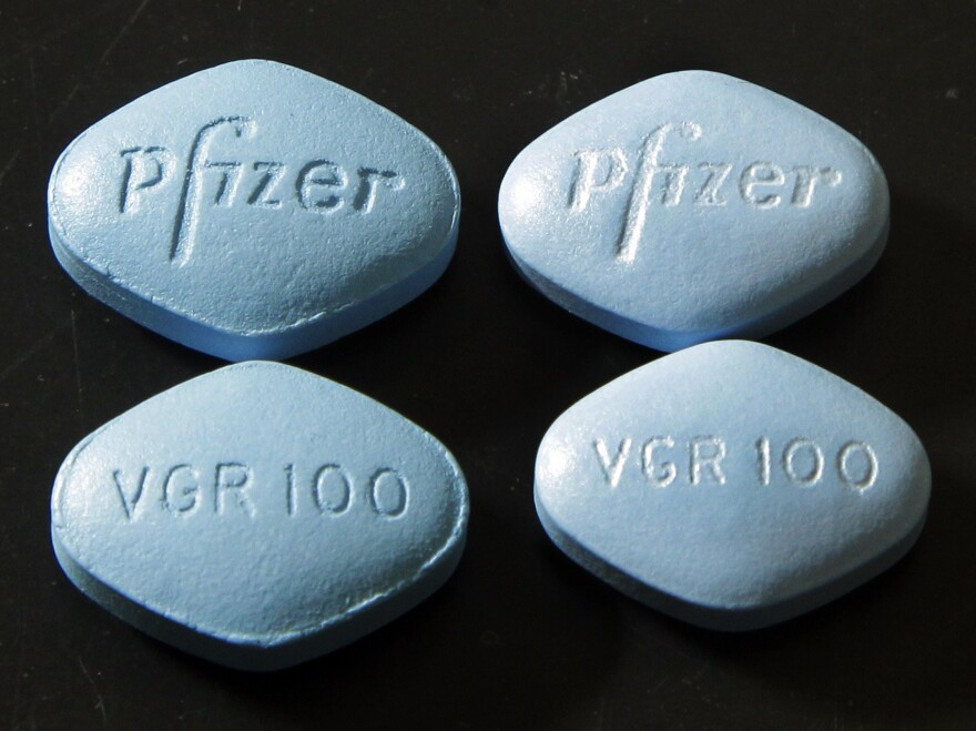 Those are counterfeit Viagra pills on the left (top and bottom) and real ones on the right (top and bottom).