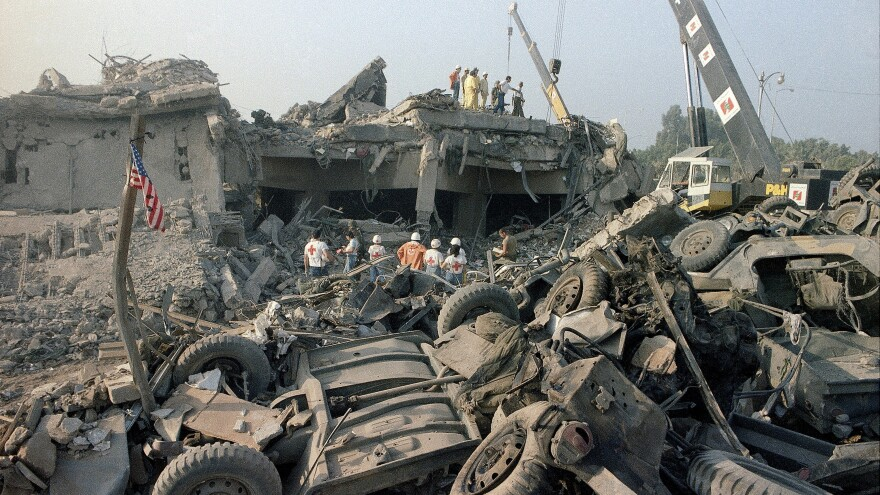 Rescuers search through the rubble of the U.S. Marine barracks Oct. 23, 1983, in Beirut after a suicide truck bombing. The blast — the single deadliest attack on U.S. forces abroad since World War II — killed 241 American service members. The Supreme Court decided Congress can pass a law compensating the victims, and those of other attacks, using Iranian government funds.