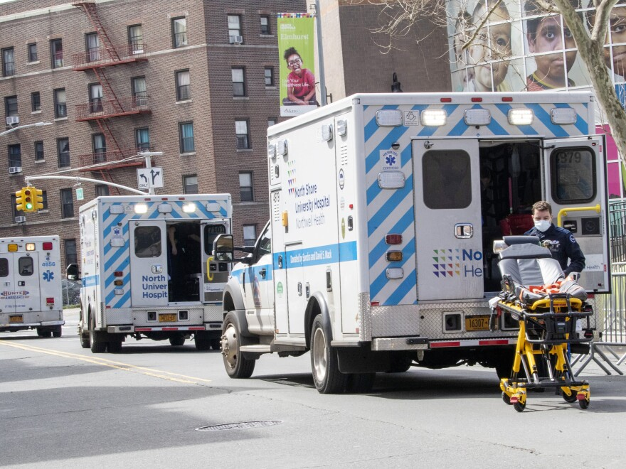 Ambulances line the street outside Elmhurst Hospital Center on Saturday in the Queens borough of New York.