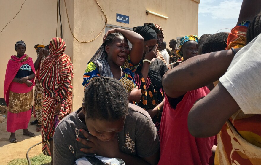 Relatives of the ambushed aid workers wait to collect the bodies of their loved ones. The photo was taken outside the morgue in Juba, South Sudan, on March 27.