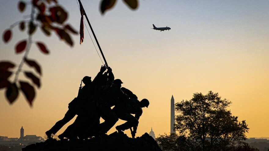 The U.S. Marine Corp's Iwo Jima Memorial near Arlington National Cemetery is seen as the morning sun rises behind the U.S. Capitol and Washington Monument in Arlington, Va.