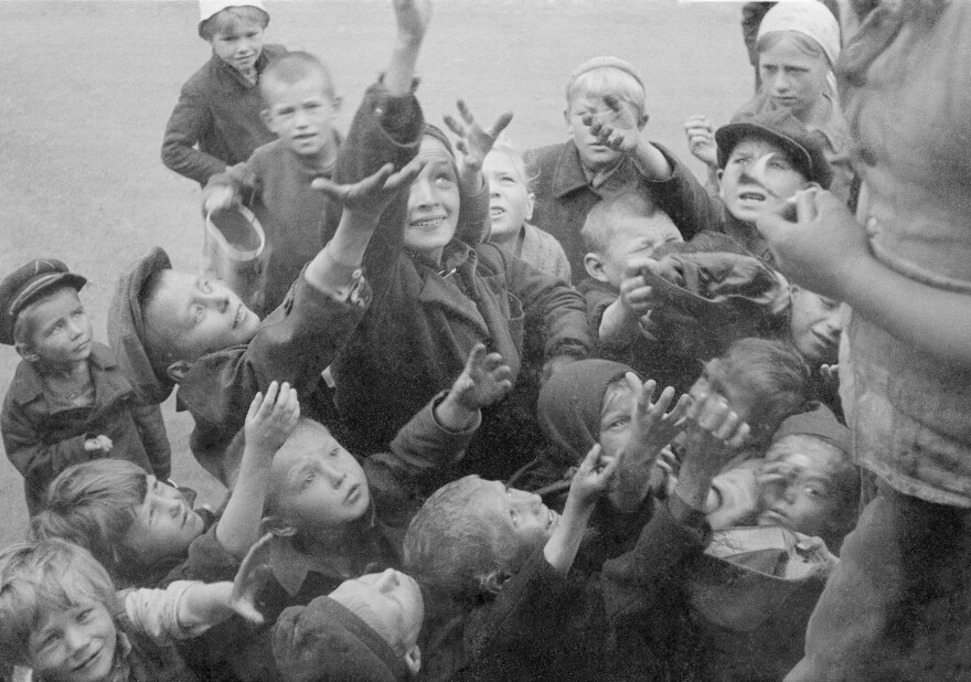 "Russian children clamor for food, circa 1941. During World War II, the Nazis sought to implement a ""hunger plan"" to starve millions from Russia and Eastern Europe."