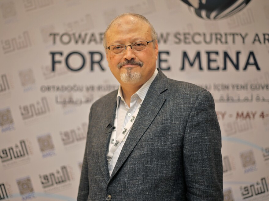 Jamal Khashoggi poses at an event in Istanbul in May. Saudi state media confirmed the journalist's death, but details remain fuzzy.