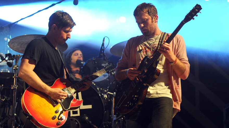 This one's virus-free: Matthew Followill, Nathan Followill and Caleb Followill of Kings of Leon performed in Los Angeles in December.