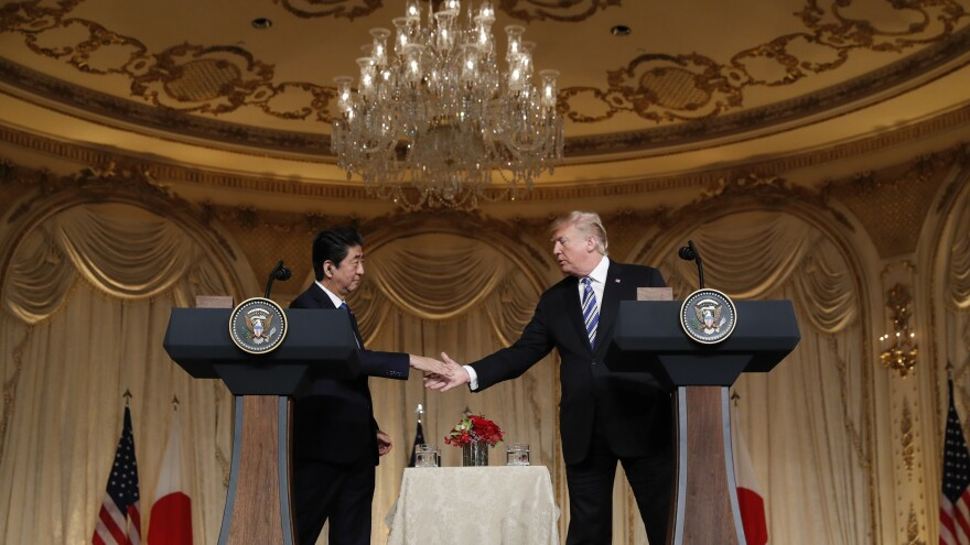 President Trump and Japanese Prime Minister Shinzo Abe shake hands during a news conference at Trump's private Mar-a-Lago club on Wednesday in Palm Beach, Fla.