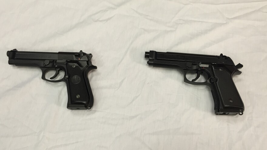 A Baltimore police officer shot and wounded a 14-year-old boy in April after spotting him with a Daisy Powerline 340 BB gun, right. A semi-automatic handgun, pictured left, provided by police shows how similar the models look.