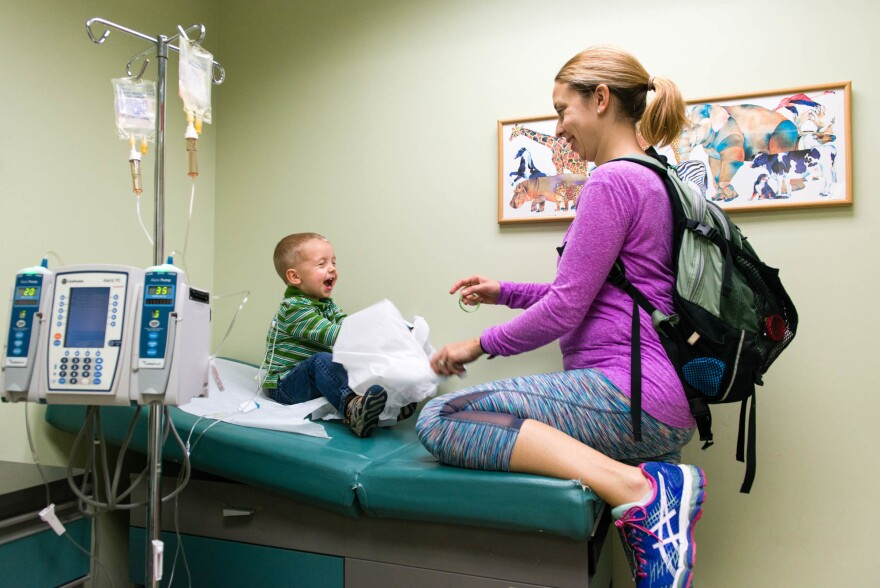Meg and Luke Whitbeck wait to be seen by the cardiologist at Maria Fareri Children's Hospital in Hawthorne, N.Y., in October.