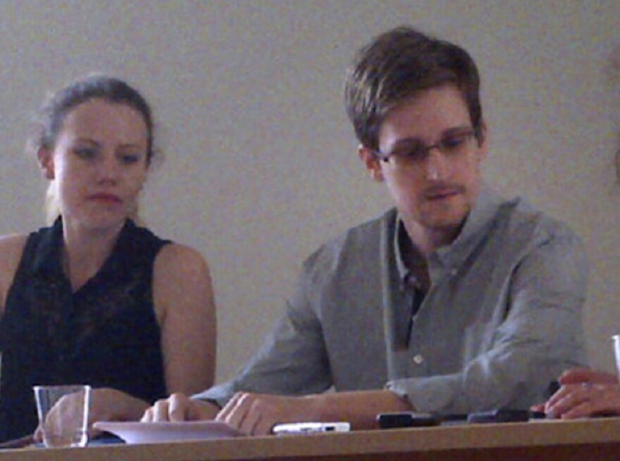 FILE - In this image provided by Human Rights Watch, NSA leaker Edward Snowden, center, attends a news conference at Moscow's Sheremetyevo Airport with in July of 2013.