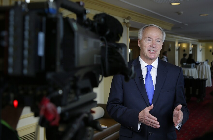 Arkansas Gov. Asa Hutchinson, pictured here during an interview last month, ended the state's Medicaid contract with Planned Parenthood two years ago. He praised the circuit court's decision.