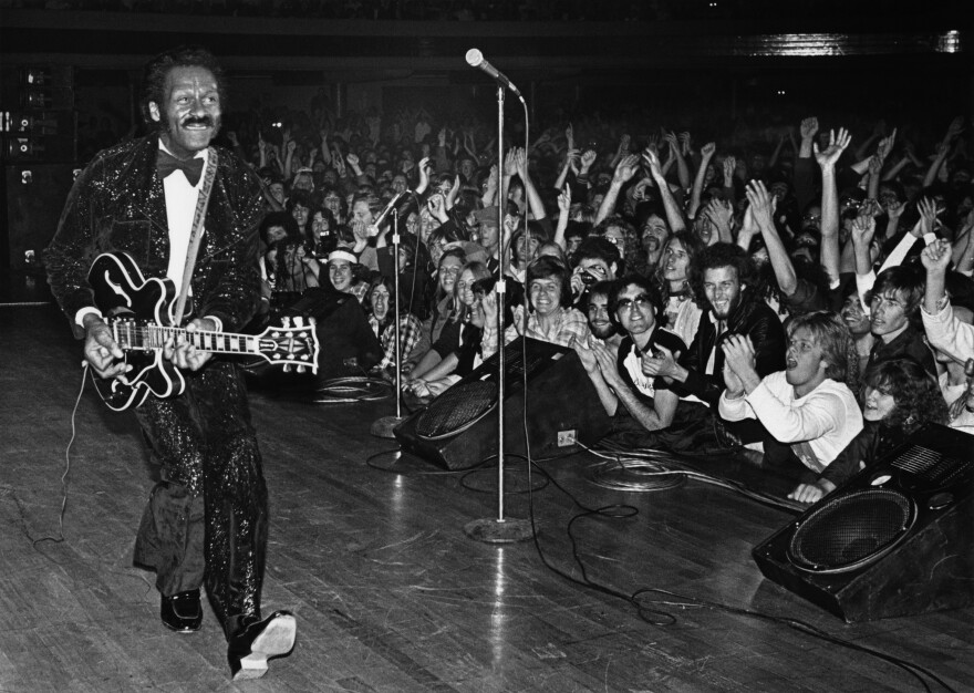 Chuck Berry struts his signature duck walk while performing in Hollywood, Calif., in 1980.