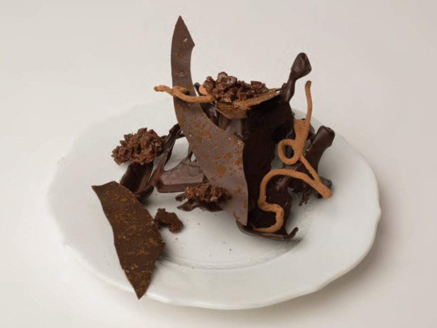 "Brooks Headley makes chocolate ""trees"" by pouring tempered chocolate into ice. He decorates them with candies. But beware: Chocolate trees are difficult to construct and to transport."