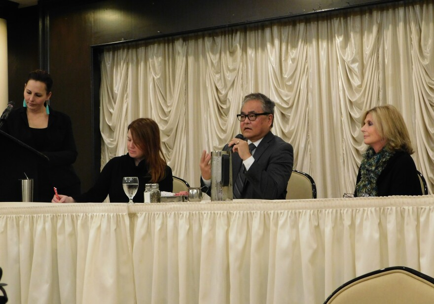 Akron photographer Shane Wynn moderates the panel of arts stakeholders at the Akron Press Club.