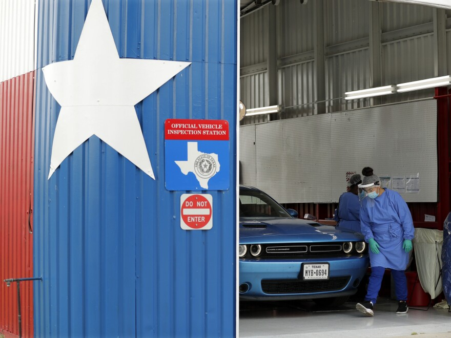 Patients can get COVID-19 diagnostic and antibody tests at a converted vehicle inspection station in San Antonio, as the state reports a record number of hospitalizations and single-day case increases.