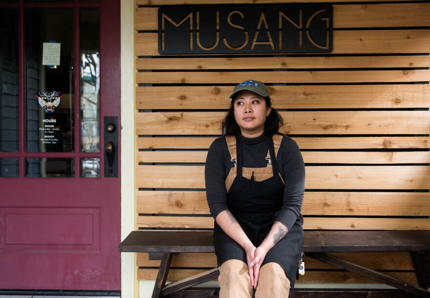 """Melissa Miranda runs a restaurant in Seattle's Beacon Hill neighborhood. Restaurant employees have been delivering food to health care workers, in addition to filling orders for takeout and delivery. """"Whether or not Musang is able to stay open — for the time being, if we have the space, we can use it. If I have to sleep here, I will,"""" Miranda says."""