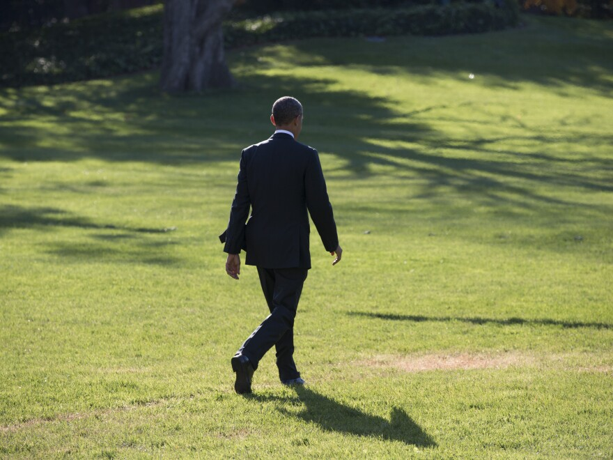 President Obama walks from the White House to Marine One on Friday. In an interview Thursday with NBC News, he apologized for breaking a promise regarding the Affordable Care Act.