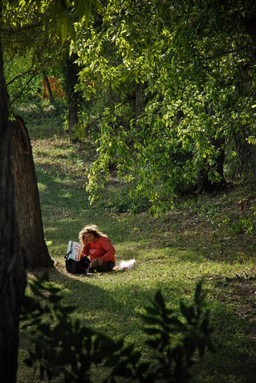 Jennifer Gale resting under a tree in Austin TX