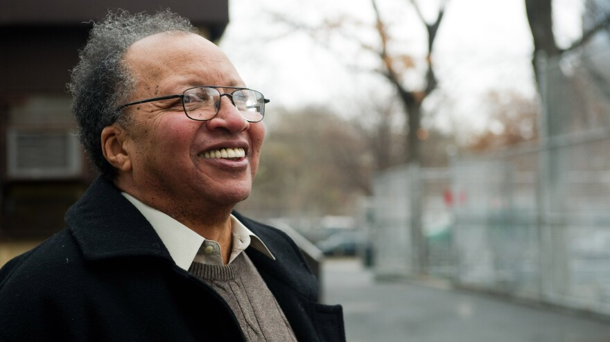 Author Walter Dean Myers tours his old Harlem neighborhood in New York in 2010.