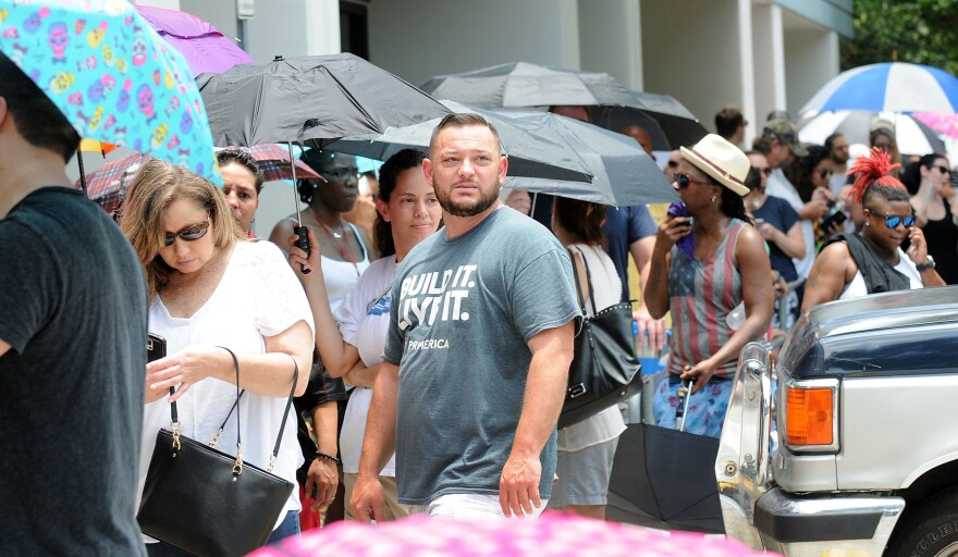 People wait in line to donate blood at the OneBlood Donation Center in Orlando, Fla, on Sunday, after a mass shooting at a gay nightclub left at least 50 people dead and 53 injured.