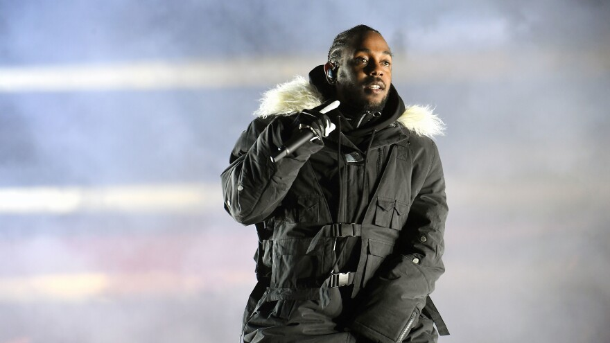 ATLANTA, GA - JANUARY 08: Rapper Kendrick Lamar performs in Atlanta's Centennial Olympic Park during halftime at the 2018 College Football Playoff National Championship Game between Georgia and Alabama.