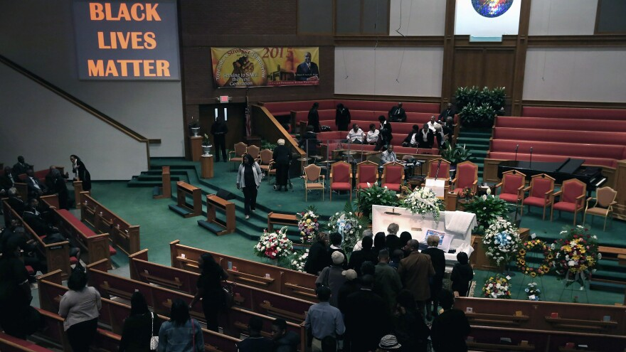 Mourners line up to pay their respects during Freddie Gray's funeral at the New Shiloh Baptist Church in Baltimore, Md., on Monday.