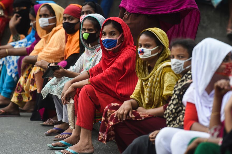 Workers from the garment sector block a road during a protest to demand payment of due wages, in Dhaka, Bangladesh, in April. Thousands of garment workers who produce items for top Western fashion brands protested against unpaid wages, saying they were more afraid of starving than contracting the coronavirus.