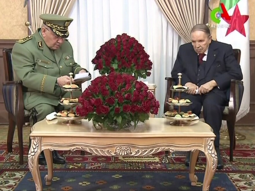 Algerian President Abdelaziz Bouteflika (right) says he won't seek re-election following weeks of mass demonstrations against his tenure. Bouteflika is shown here meeting with Algeria's army chief, Ahmed Gaid Salah, in Algiers, in a video grab from footage broadcast by Algeria's Canal Algérie network.