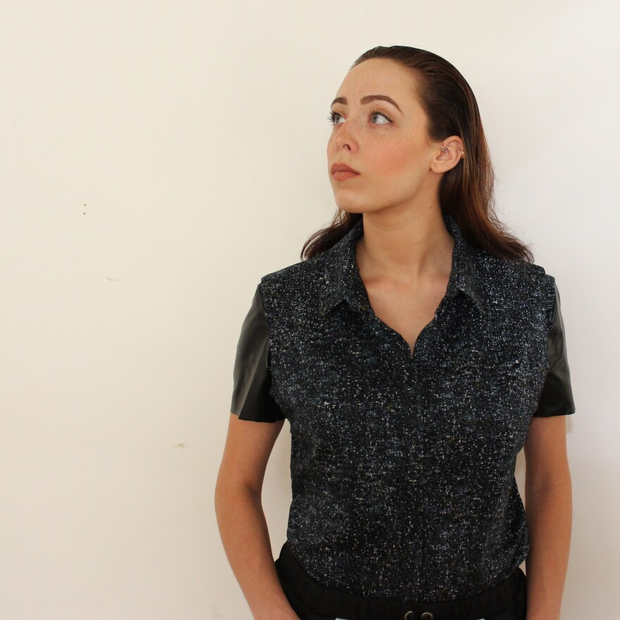 Model Samantha Poulis wears an adjustable blouse that was designed and created for someone with an upper-body amputation.