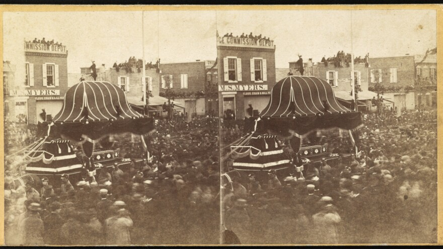 A crowd surrounds President Abraham Lincoln's funeral procession in Philadelphia in 1865. After his assassination in Washington, Lincoln's body was taken on a 1,700-mile train trip that stopped in major cities on its way to his home in Springfield, Ill. This stereo image, with two almost identical views, could be seen with a stereoscope to create the perception of a 3-D image.