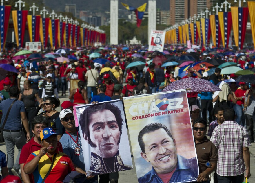 Supporters line up to pay their last respects to late Venezuelan President Hugo Chavez, outside the Military Academy in Caracas on Thursday.