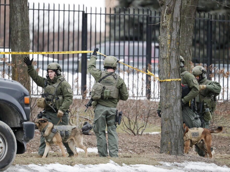Police respond to reports of an active shooting at the Molson Coors Beverage Co. campus in Milwaukee on Wednesday. Police said the shooter was a 51-year-old Milwaukee man.
