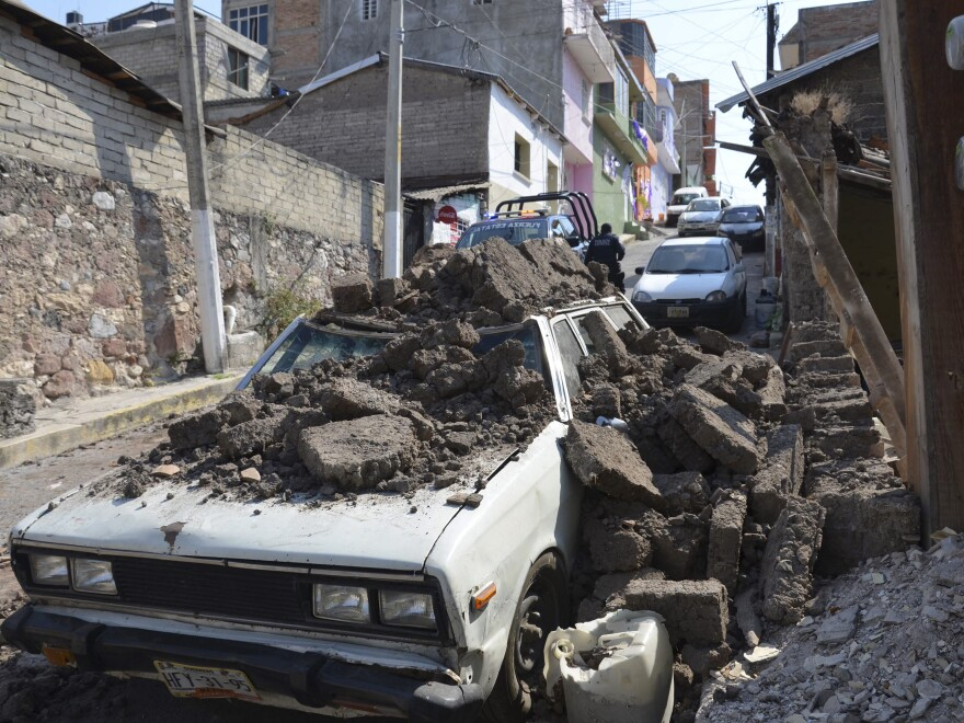 A parked car suffered damage when a adobe wall collapsed on it after a strong earthquake shook Chilpancingo, Mexico, on Friday, but there were no early reports of major damage or casualties.
