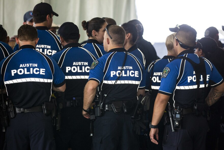 Austin police officers huddle during a briefing before the start of the ACL festival in 2019.