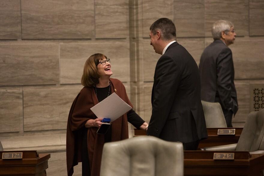 Sen. Jill Schupp, D-Creve Coeur, speaks with Sen. Bill Eigel, R-Weldon Spring, during the first day of the 2020 legislative session.