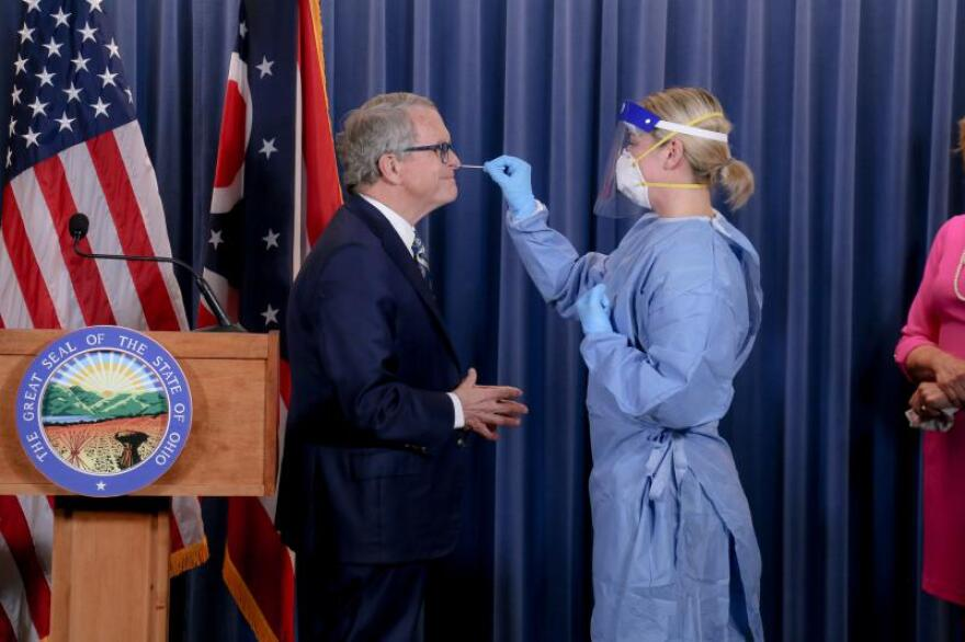 Gov. Mike DeWine took a COVID-19 test during his coronavirus briefing administered by a member of the Ohio National Guard on June 23. That test was negative.