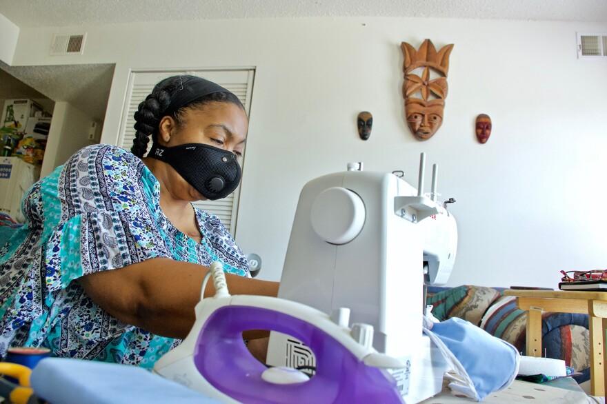 Kim Daniel sewing masks at a machine