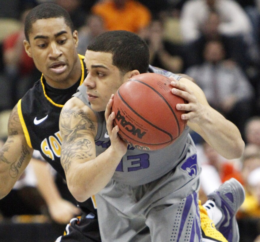 Kansas State's Angel Rodriguez (13) gets control of a loose ball in front of Southern Mississippi's Neil Watson during the first half of an East Regional NCAA tournament second-round college basketball game on Thursday.