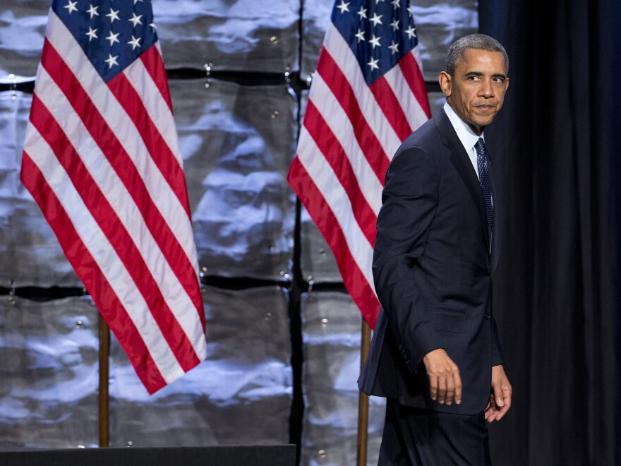 """President Obama walks off stage after speaking at the """"SelectUSA Investment Summit"""" on Thursday. A poll released the same day found that the president's job approval rating had reached an all time low."""