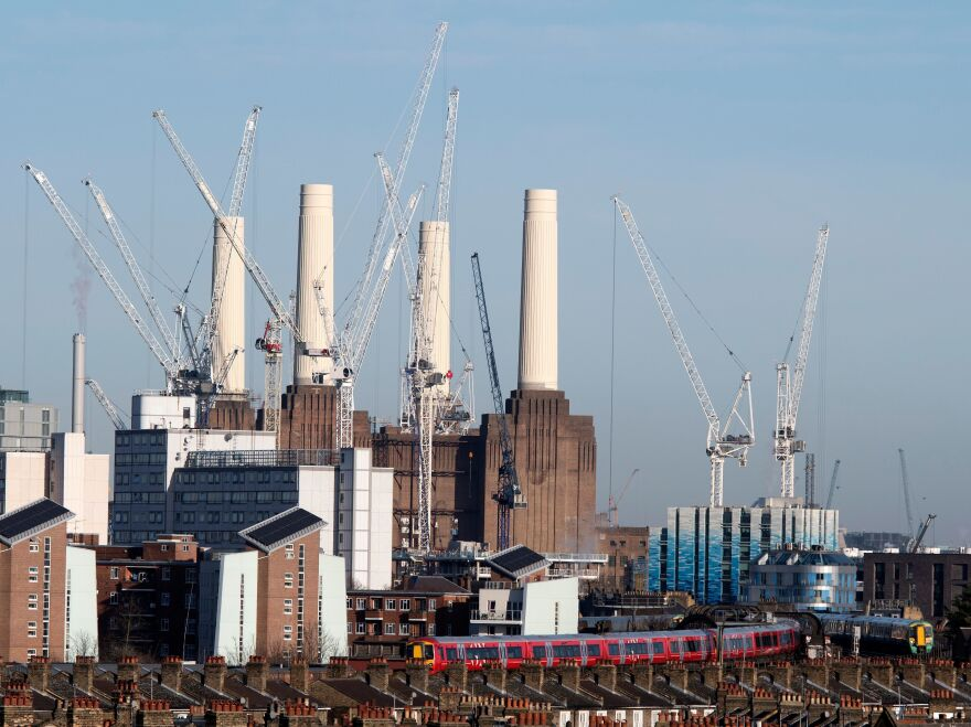 Passenger trains pass through Battersea Park rail station as construction work continues on the Battersea Power Station residential and retail development complex in London in December.