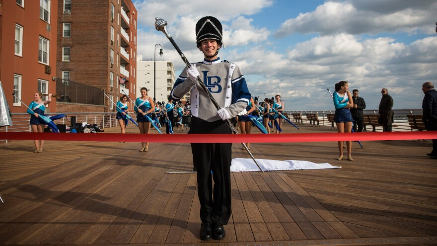 The Long Beach High School marching band prepares to march down the Long Beach boardwalk during a ribbon-cutting ceremony Friday.