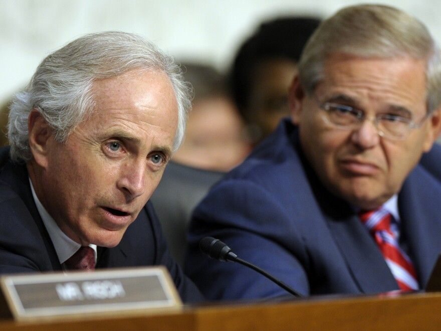 Senate Foreign Relations Committee Chairman Sen. Robert Menendez, D-N.J., listens as the committee's ranking Republican, Sen. Bob Corker of Tennessee, speaks before Wednesday's vote.