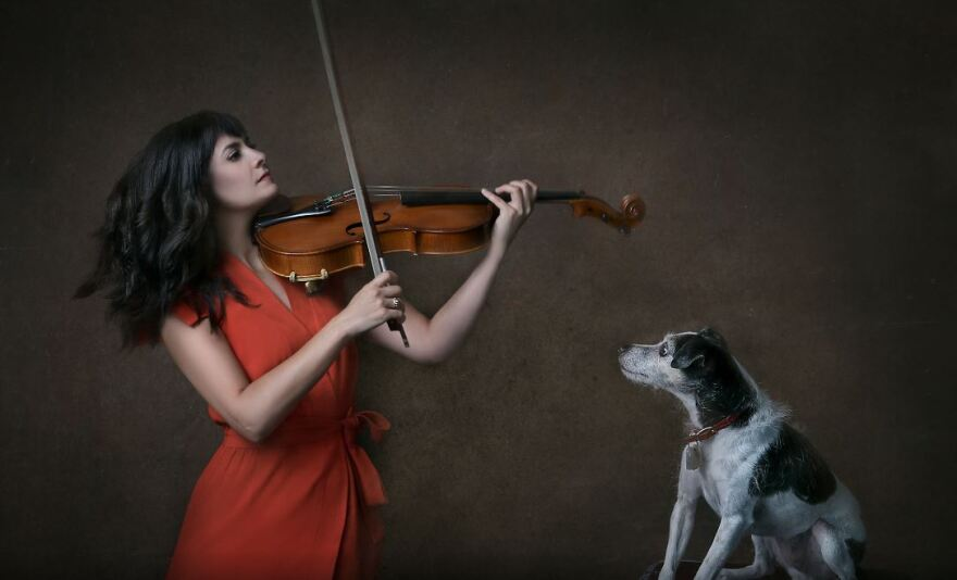 Marisa Bushman, a violist with the chamber group Agarita, and her dog.