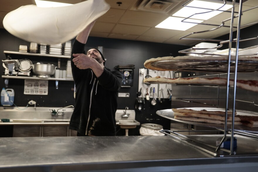 "Andrew Lopez makes a pizza in his restaurant, Lopiez, in Davenport. ""It's been getting a little worse and worse every year,"" he says of extreme weather."